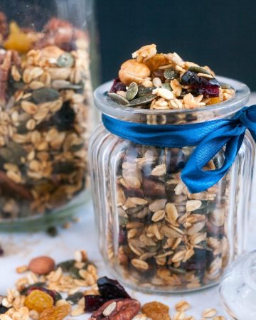 A jar full with fruit and nut granola.