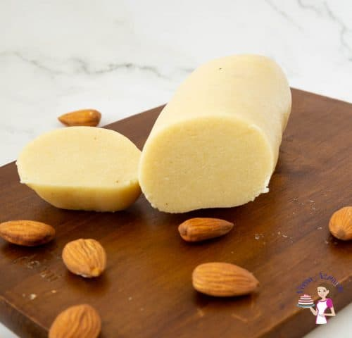 marzipan and almonds on a wooden baord