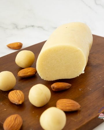Marzipan and almonds on a wooden board