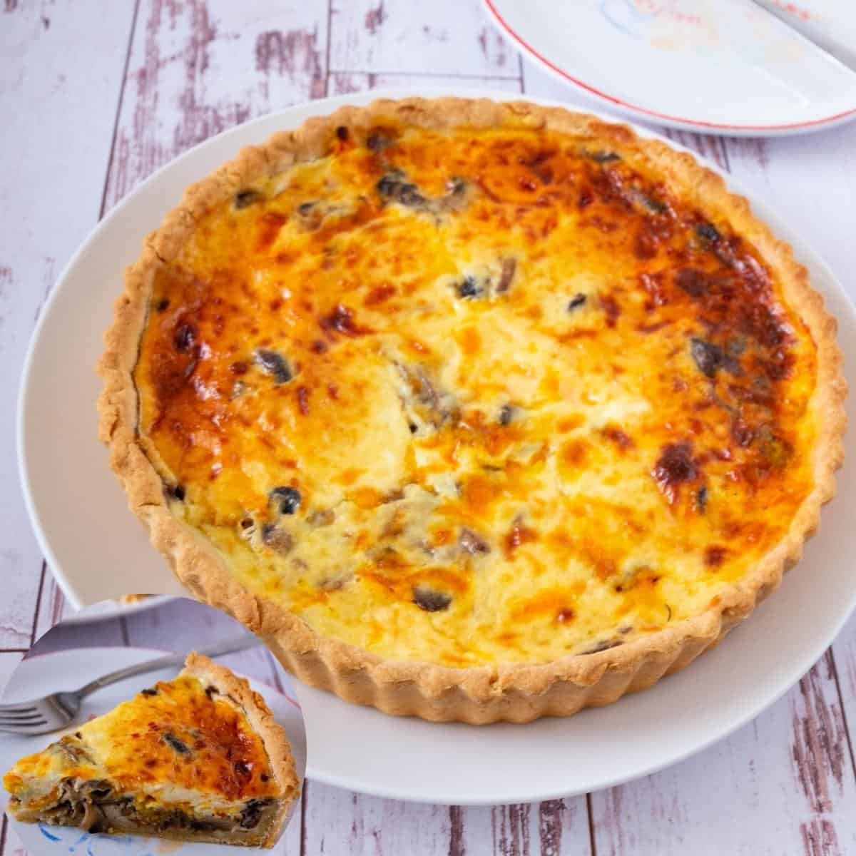 Quiche on a table with mushrooms.