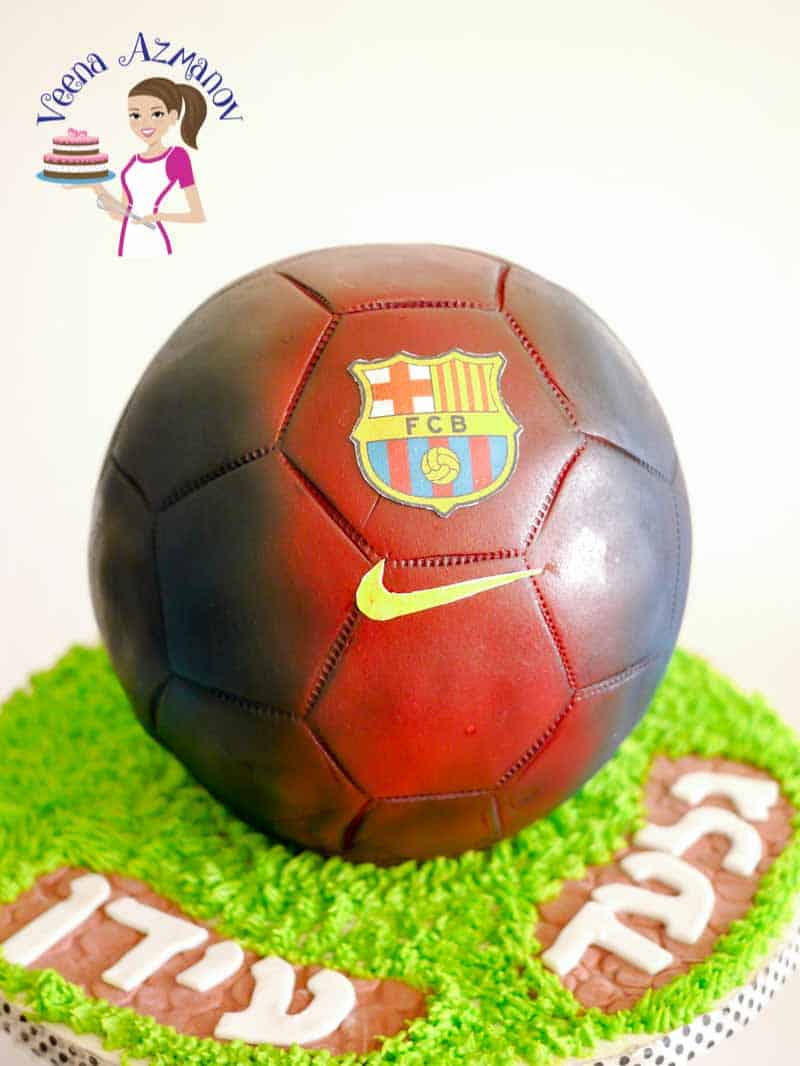 A cake decorated to look like a soccer ball.