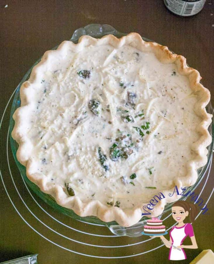 Progress photo of a mushroom quiche before being baked in the oven.
