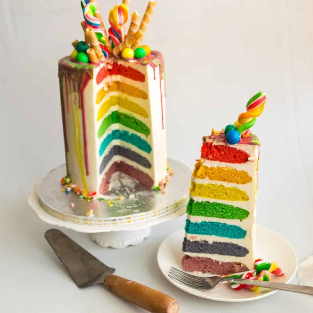 Rainbow cake topped with candy and wafer