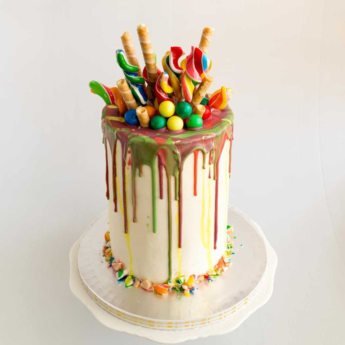 Rainbow cake on a cake stand