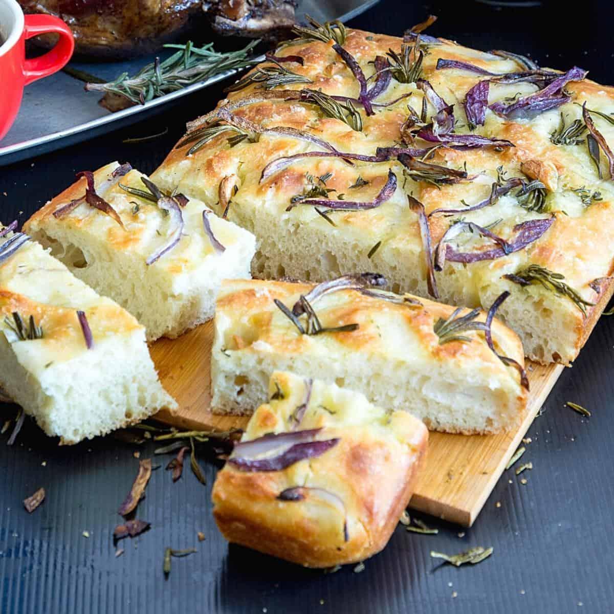 Focaccia bread on a wooden board.