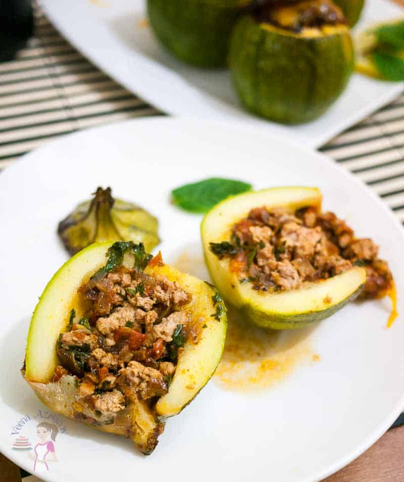 Image showing the cut squash in half stuffed with ground meat inside - These Moroccan squash recipe make very impressive appetizers