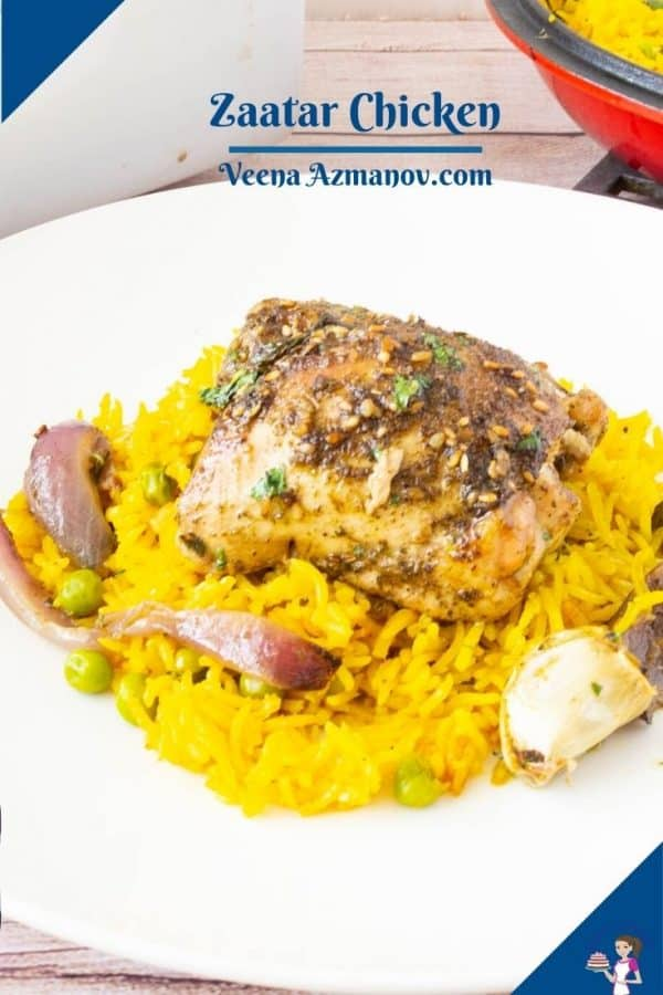 A plate with zaatar chicken served over turmeric rice.