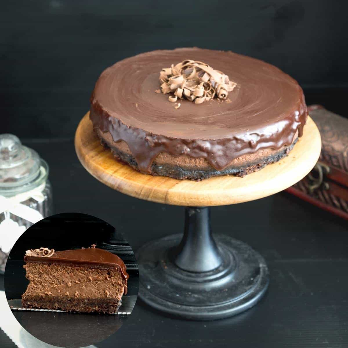 Cake stand with baked cheesecake with chocolate glaze.