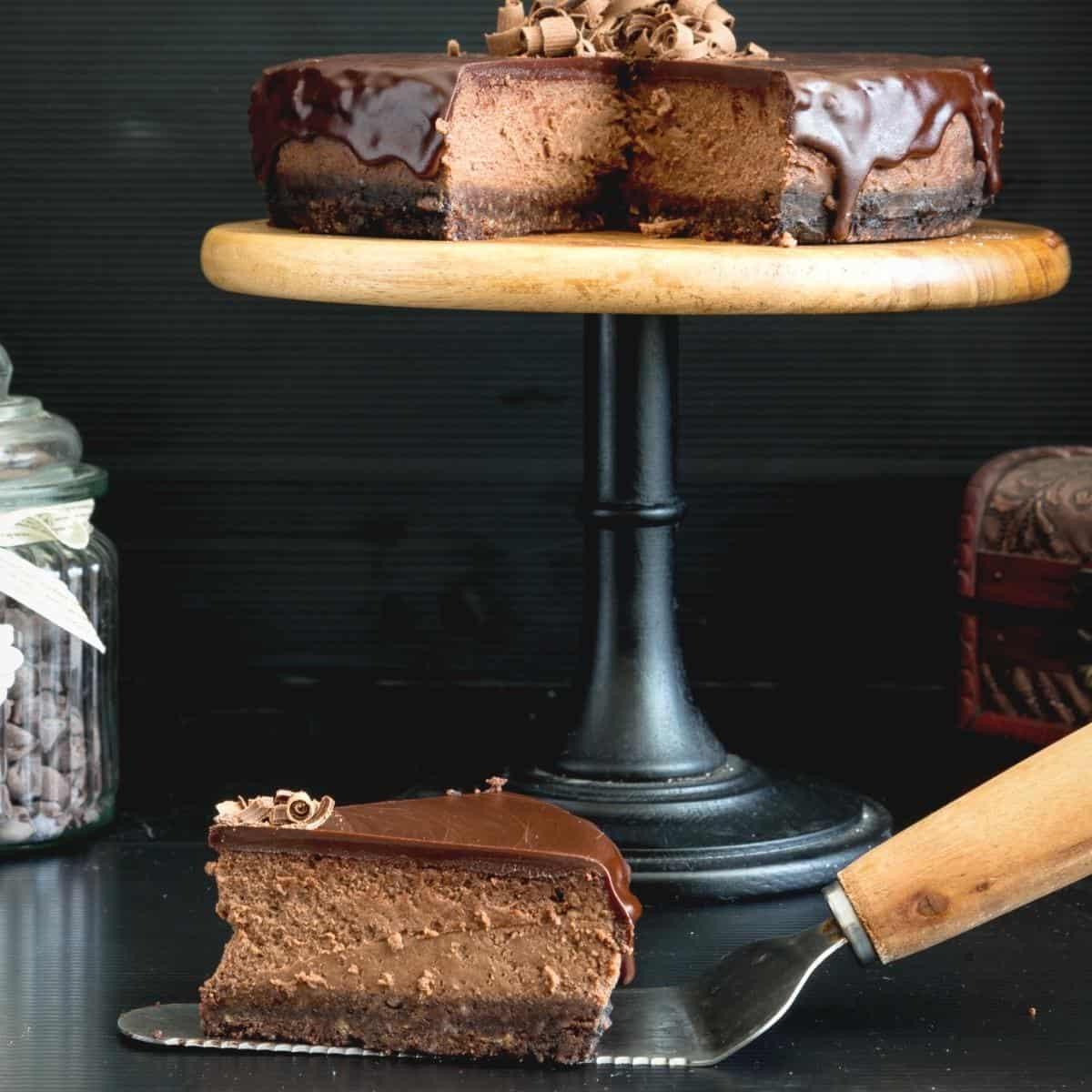 Sliced Chocolate cheesecake on a cake stand.