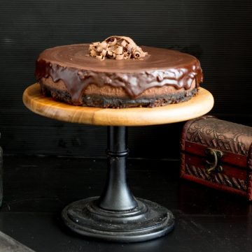 Chocolate cheesecake on a wooden cake stand