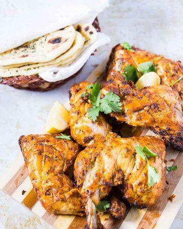 Chicken tandoori on a board.