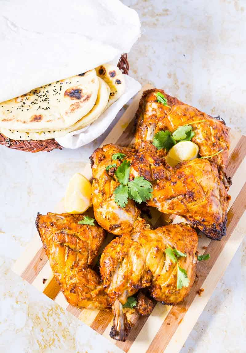 A Top view of the five chicken quarters of tandoori chicken, made with Indian spices in a yogurt marinade