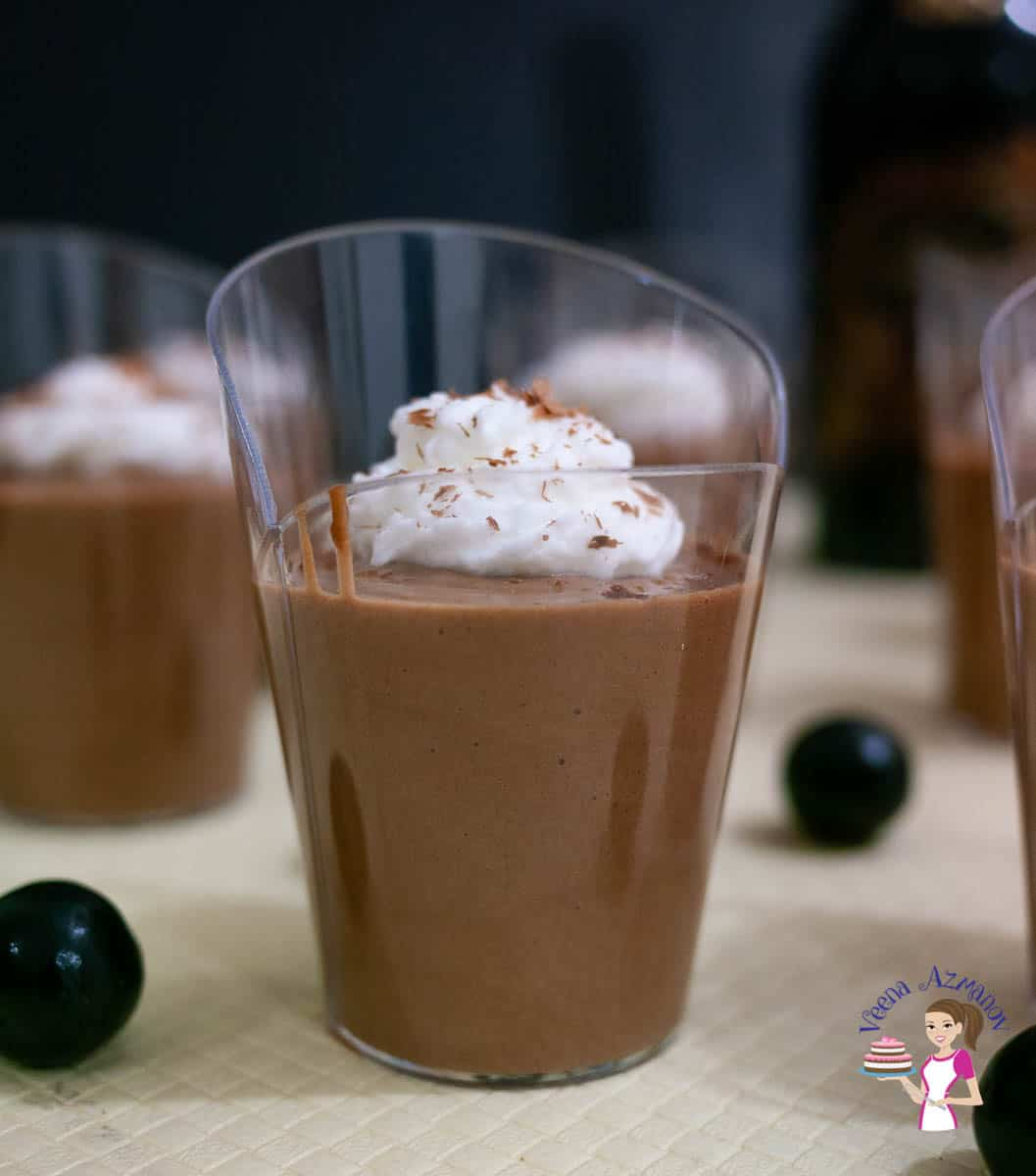 A glass with eggless chocolate mousse topped with whipped cream