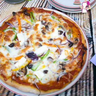 An image optimized for social sharing for this homemade pizza recipe with step by step tutorial and progress pictures so you can make the best homemade pizza every single time.