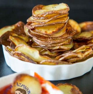 These oven baked potato chips make perfect sides to a main course, served with your burgers, fish and chips, roast chicken or just as a snack when you craving for some fatty potato chips. A simple, easy and effortless recipe that will have you eating oven fried potato chips with fraction of oil used in traditional deep fried potato Chips.