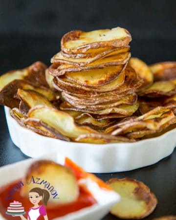 A plate with oven baked potato chips.