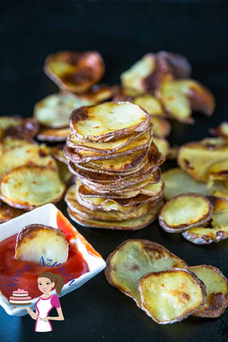These oven-baked potato chips make perfect sides to a main course, served with your burgers, fish and chips, roast chicken or just as a snack when you craving for some fatty potato chips. A simple, easy and effortless recipe that will have you eating oven fried potato chips with fraction of oil used in traditional deep fried potato Chips.
