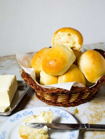 These homemade soft dinner rolls are the best thing to have with any meal or make a sandwich for a quick snack. This simple, easy and effortless recipe using regular all purpose flour, sugar, butter and instant yeast makes the softest buns with a tender crumb that can be an addiction.