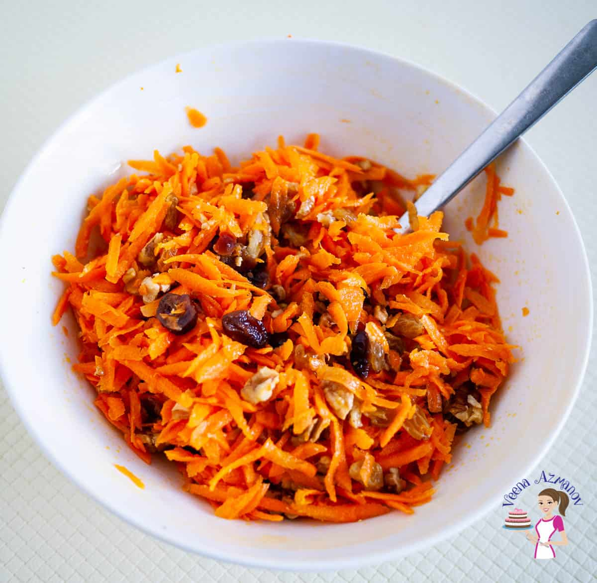 Carrot salad in a white bowl