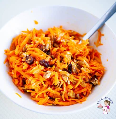 A white bowl with carrot salad