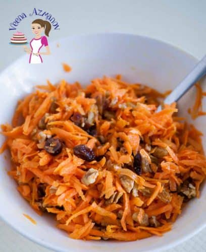 A great way to eat carrots is to make a delicious salad. Not just because salad is healthy or carrots are nutritious but they are tasty too! Throw in a few raisins, cranberries and pecans and what you have is a delicious Quick Carrot Salad with raisins, cranberries and Nuts.