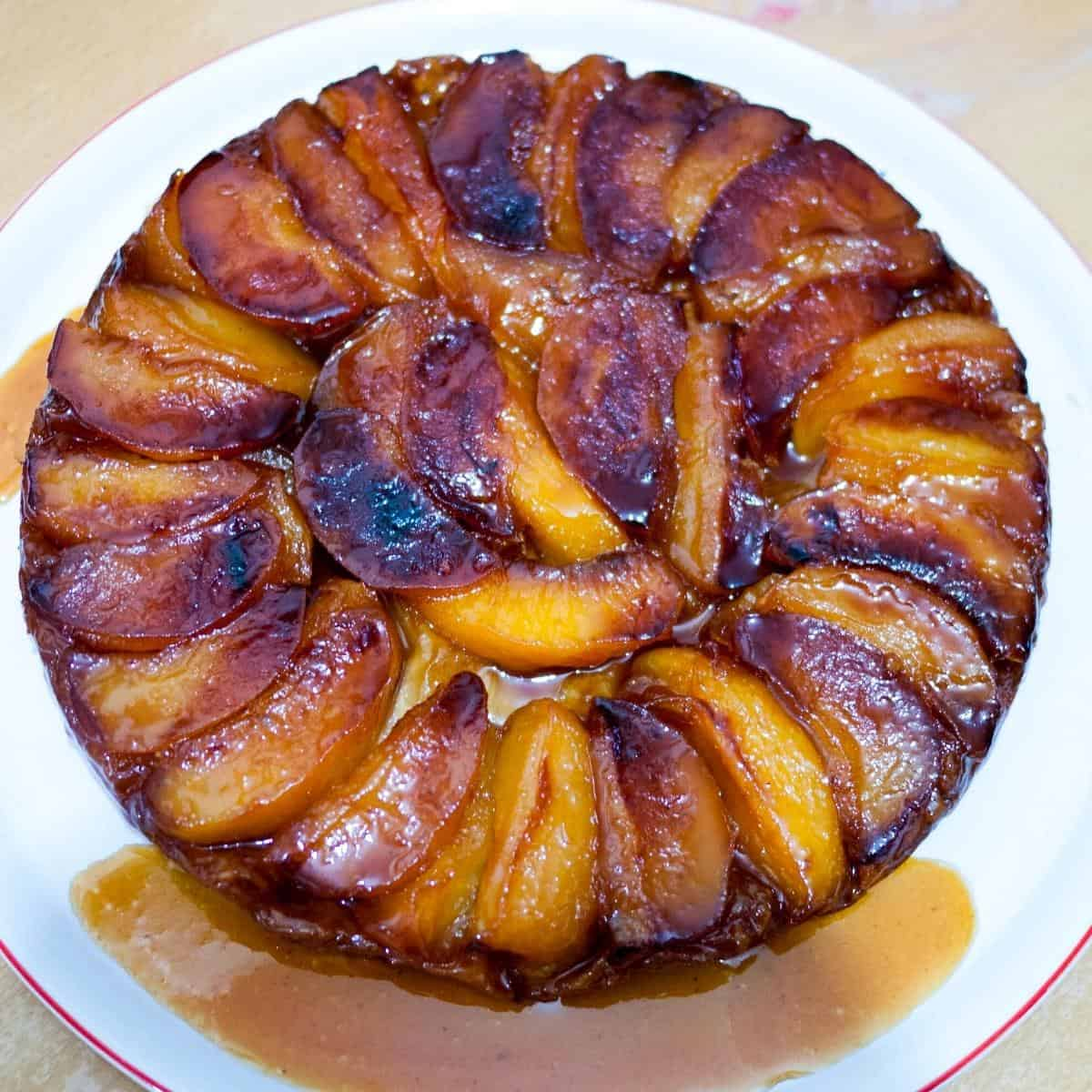 A plate with upside down apple tarte.