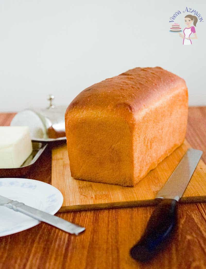 A full loaf of bread before cutting it - baked till golden - Perfect white sandwich bread recipe