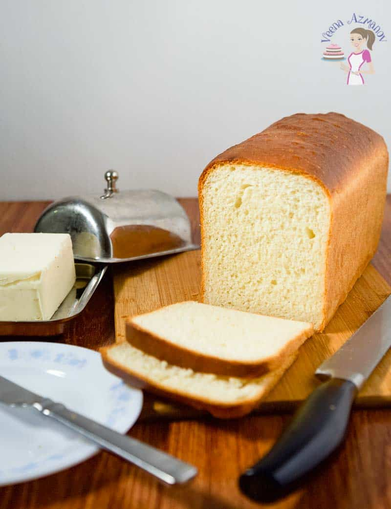 A close up of the cut loaf of bread for this white sandwich bread recipe baked from scratch