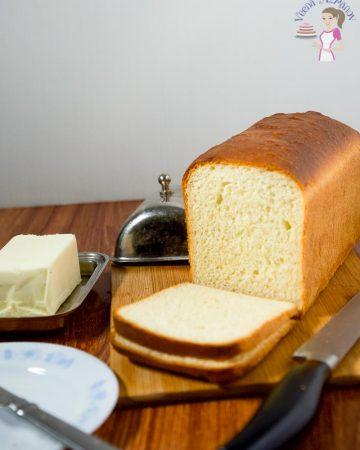 Sliced sandwich bread on a wooden board.
