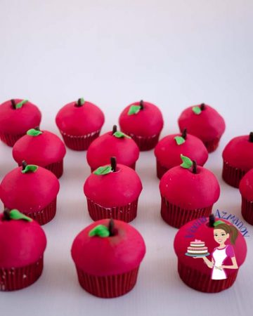 Cupcakes decorated like apples.