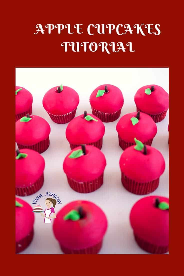 Cupcakes decorated with fondant to look like red apples.