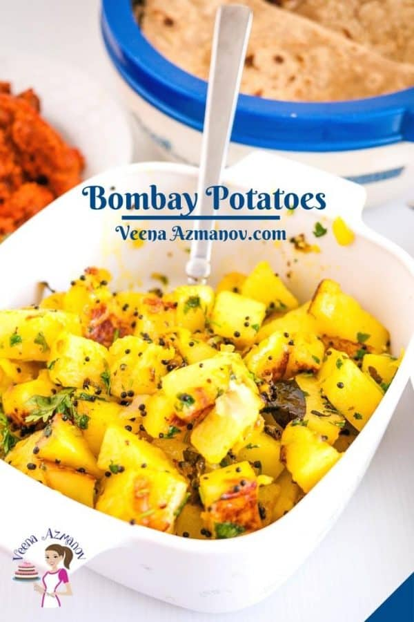 Pinterest image for spiced Indian potatoes.