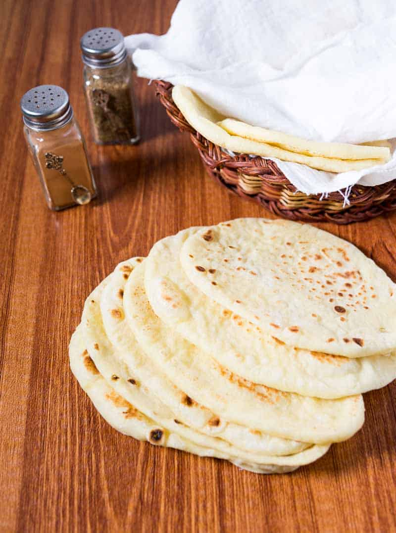 A pile of homemade stovetop naan breads made with all purpose flour, yogurt and eggs.