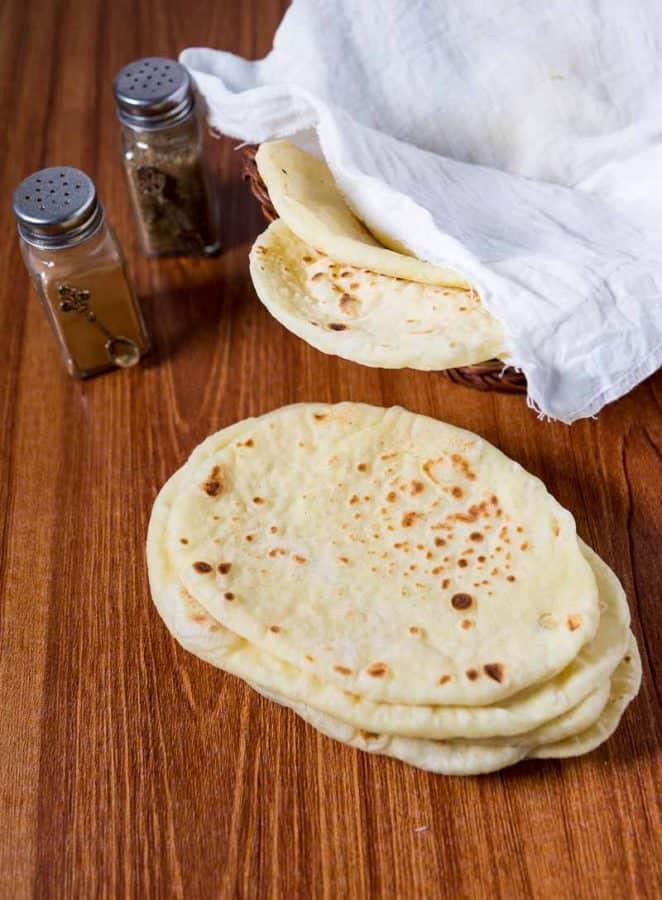 Garlic naan bread on a table.