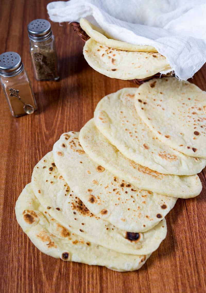 The homemade naan is an absolute treat, which when made properly just melts in the mouth. This simple, easy and effortless recipe will make the most deliciously soft and supple bread that can be used to scoop any Indian curry, wrapped around meats. This recipe works perfectly when made on the stovetop, baked in the oven or even grilled on a hot summers day.