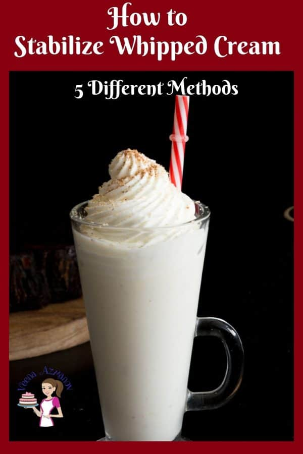 A glass of cold coffee with whipped cream on top.