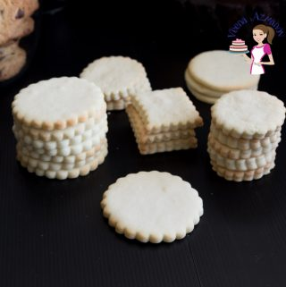 Stacks of vanilla sugar cookies on a table.