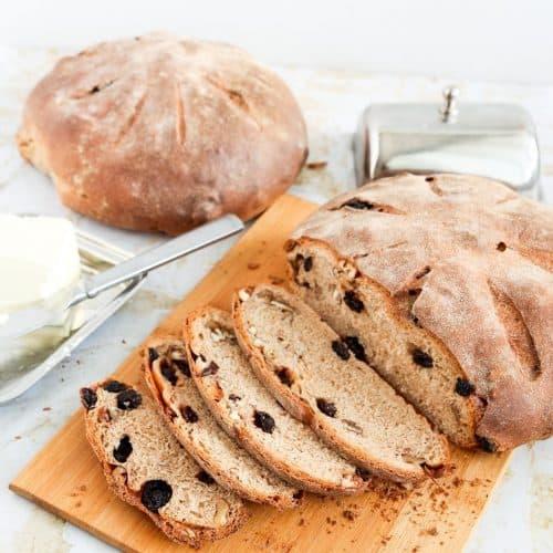 Raisin walnut bread on a wooden board.