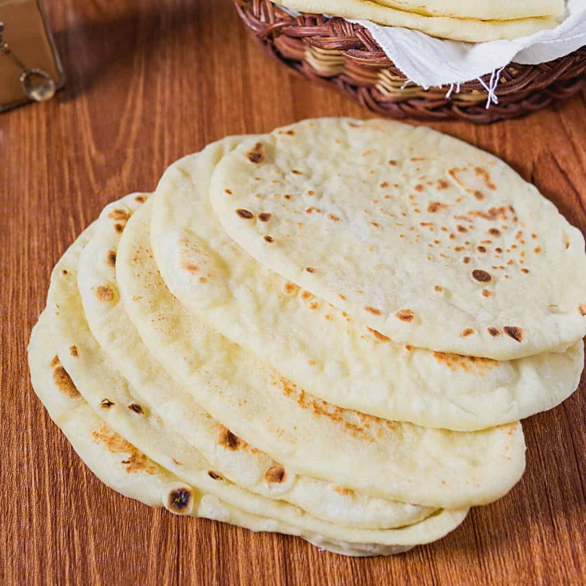 Homemade naan on a table.