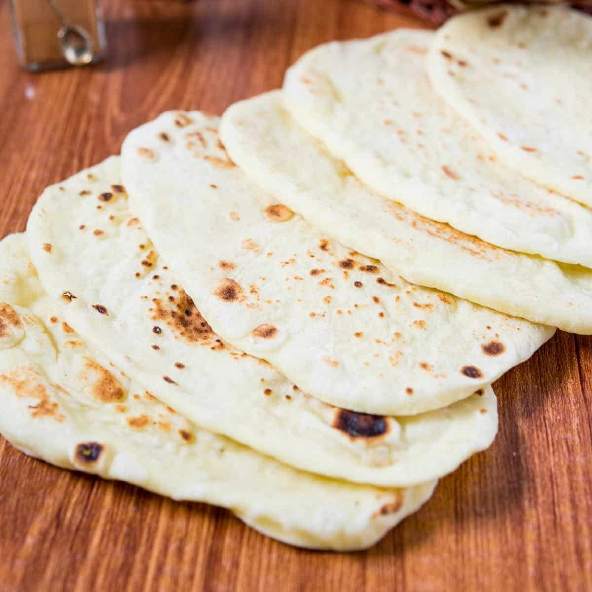 A stack of Indian naan on a table.