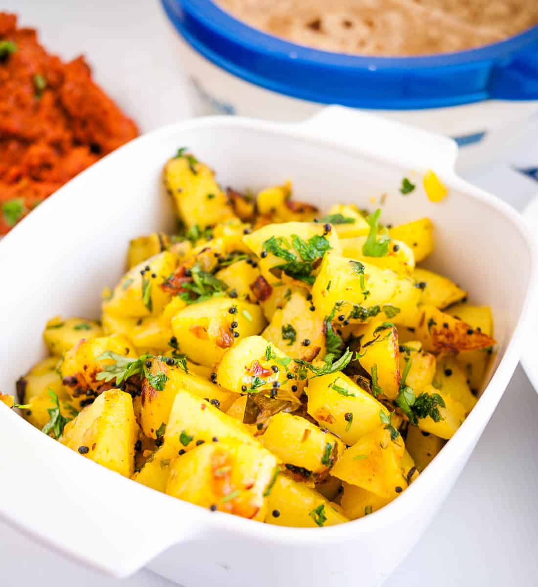 A dish with spiced potatoes made Indian style.