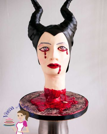 A cake designed like the head of Maleficent.