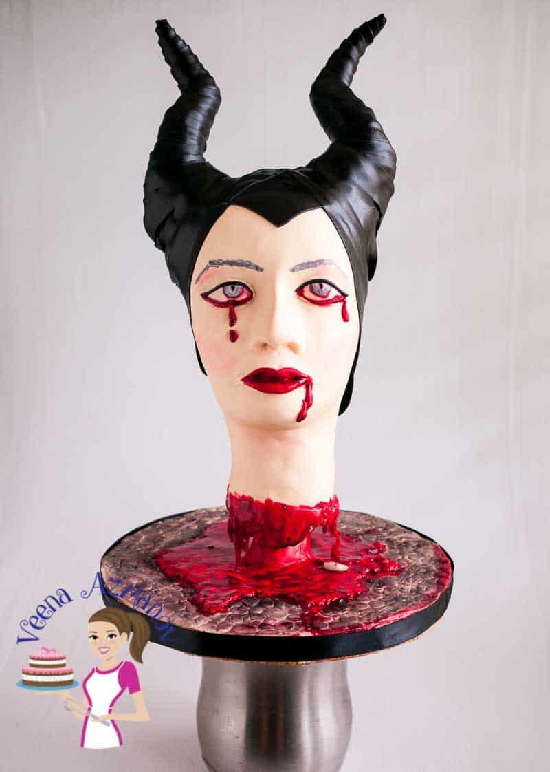 Got to love a twist on a Disney's classic, our decapitated Maleficent is crying tears of blood. This wonderful piece was created by the talented Veena for the collaboration Cakes that go bump at night.