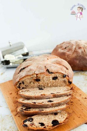 This whole wheat bread with raisins and nuts is nutritious, delicious and healthy. This simple, easy and effortless recipe makes a rustic whole wheat raisin walnut bread that lighter in texture with a crisp crust that melts in the mouth. Black raisins and walnuts evenly dispersed means you can eat this bread on its own or accompanies with a meal.  Try making bruschetta with a few slices for a delicious appetizer.