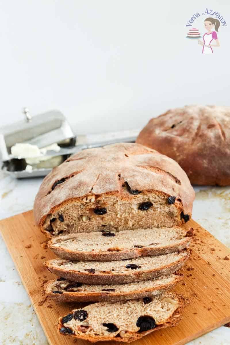 Front view of this cut whole wheat raising walnut bread showing the light and airy structure of the inside