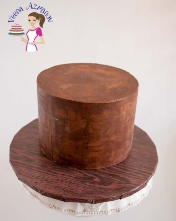 A cake decorated with chocolate ganache.