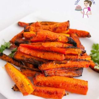 A plate of baked carrots.
