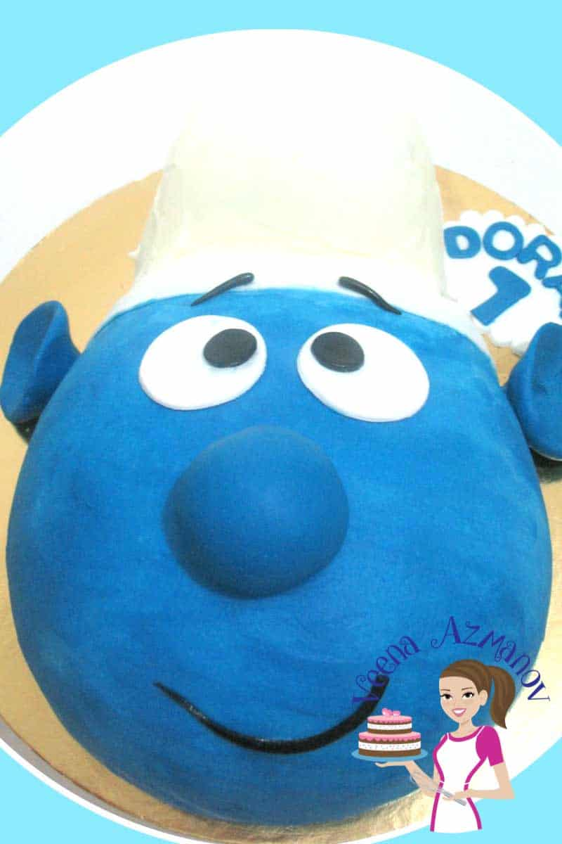 A smurf face cake can make a fun simple easy cake for a kids birthday. You do need any special skills or equipment to make this cake its' so easy!! A step by step guide is here to help you.