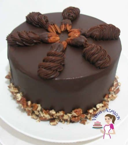 This chocolate ganache chocolate cake is really decadent and truly a chocolate dream made with a flourless chocolate cake base, filled with chocolate ganache, drizzled with more chocolate and then pipped with more chocolate swirls.