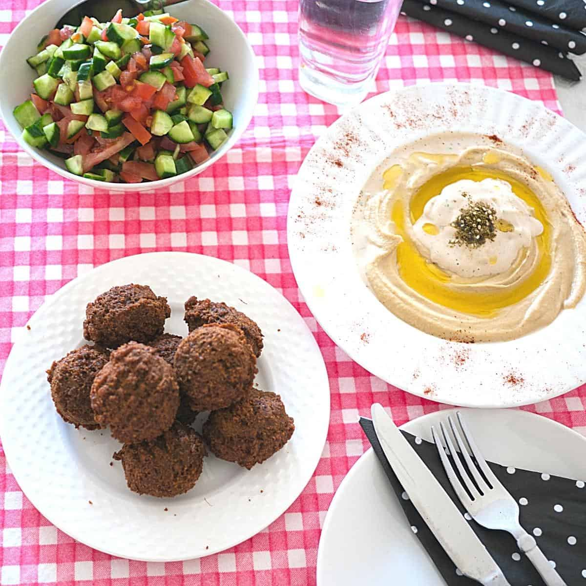 Falafel with hummus on a table.
